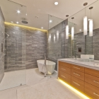A variety of silhouette lighting gives this contemporary bathroom an edge.